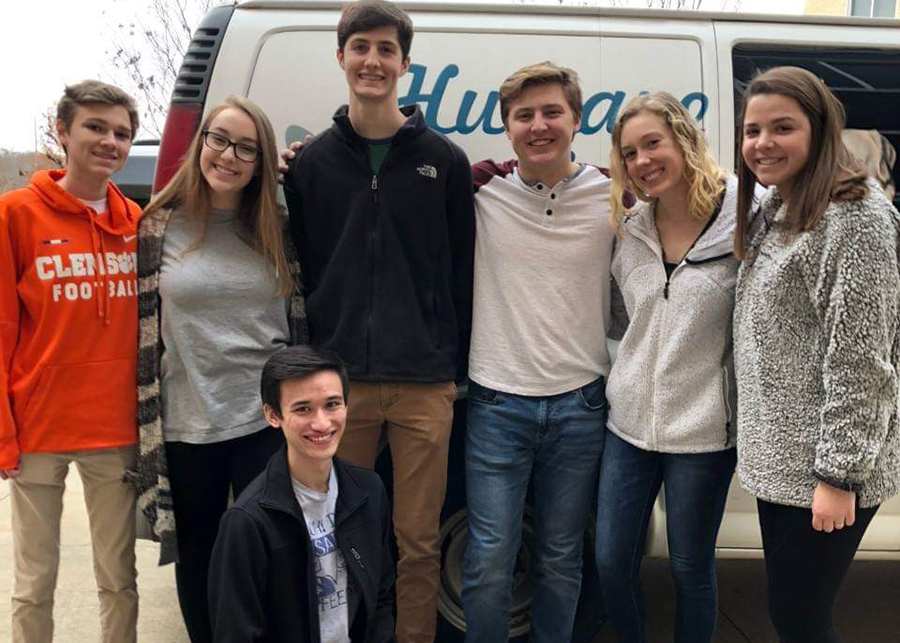 A group of students volunteering